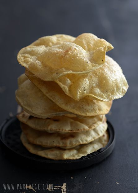 papadum is a thin, crisp disc-shaped food typically based on a seasoned dough made from black gram (urad flour), fried or cooked, with dry heat. flours made from lentils, chickpeas, rice, or potato can also be used. [India] [Pakistan] [purevege]