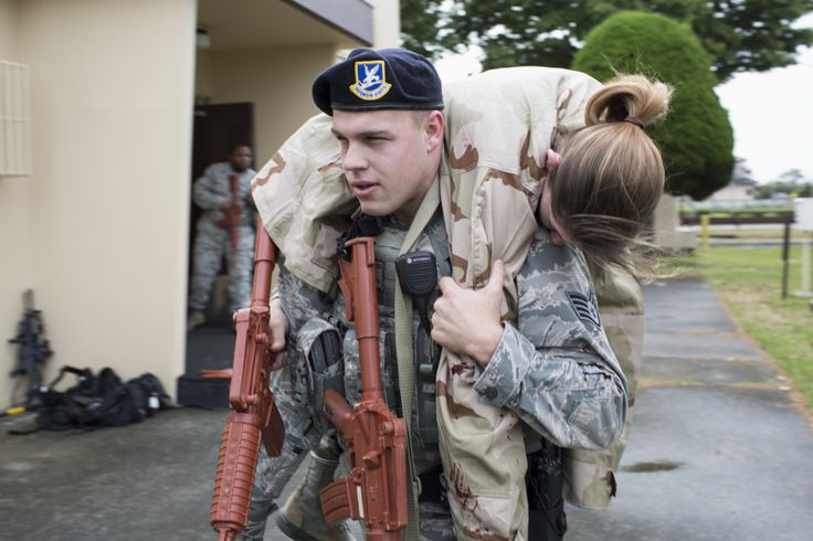 Staff Sgt. Anthony Hayes, 374th Security Forces Squadron patrolman, performs a fireman's carry during a simulated active shooter scenario at Yokota Air Base, Japan, May 15, 2014. The scenario tested the capability of Yokota's first responders. (U.S. Air Force photo by Osakabe Yasuo/Released)