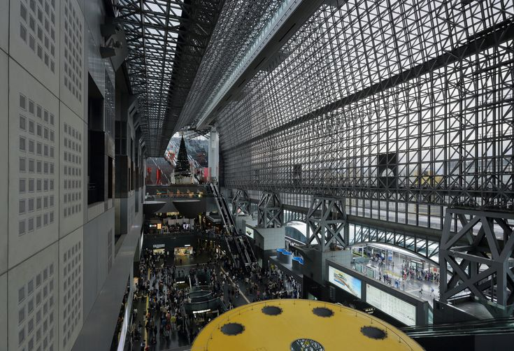Picture of the day for June 20 2017   Kyoto Station is a major railway station and transportation hub in Kyoto Japan. It has Japan's second-largest station building and is one of the country's largest buildings incorporating a shopping mall hotel movie theater Isetan department store and several local government facilities under one 15-story roof. The current station opened in 1997 commemorating Kyoto's 1200th anniversary. It is 70 meters high and 470 meters from east to west with a total…