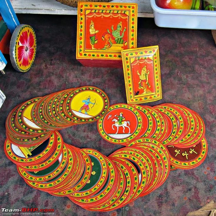 a pack of cards, called Ganjifa. Ganjifa, or originally Ganjifeh, is a Mughal era game of cards. In Sawantwadi, an Indian version of the game is played. The pack of cards has 120 hand-drawn round cards, and it is played by three persons. The system of the game is interesting, though a bit complicated. The cards however were very beautiful to look at, with each card painted intricately. It requires a lot of time for an artist to create one pack of such cards. Size: 311.0 KB