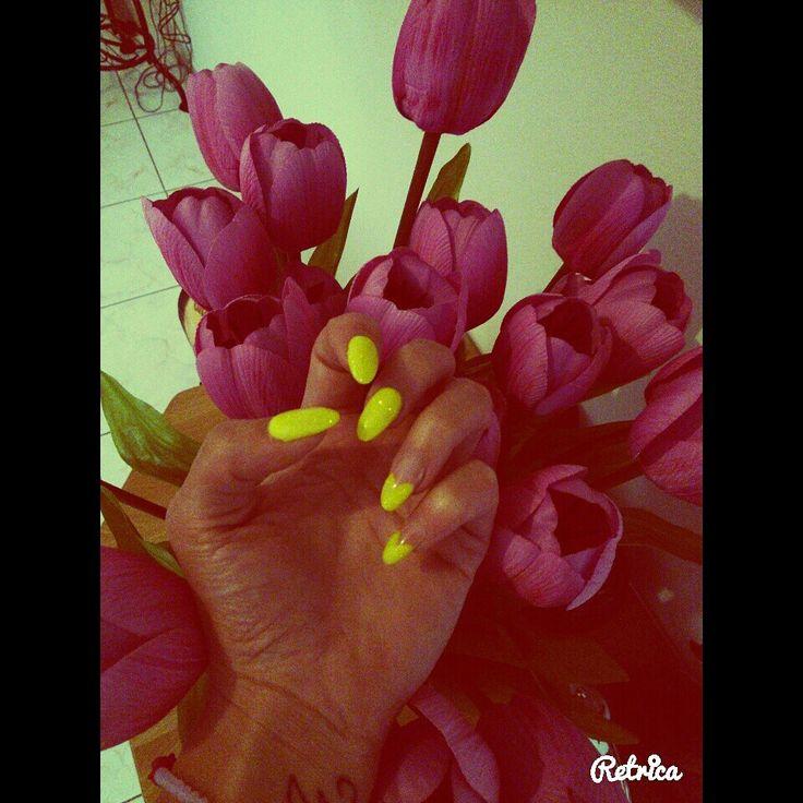 Neon yellow nail art. .