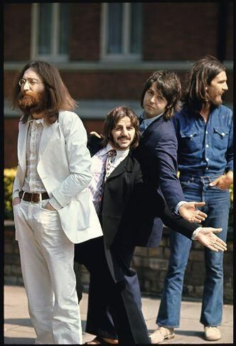 the Beatles resort to begging on street corners and John does not like it one bit.