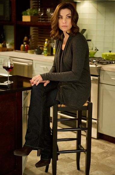 The Good Wife Fashion: Julianna Marguiles in a Donna Karen Sweater, Paige jeans and Prada boots.