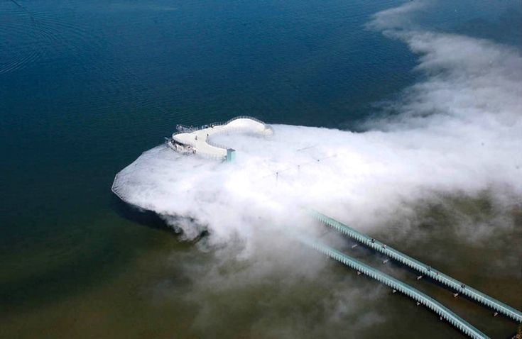 Cloud Building: This building was constructed on the Swiss lake Neshat. With the help of 31.400 nozzles which distill water into steam it creates the cloud-like effect.