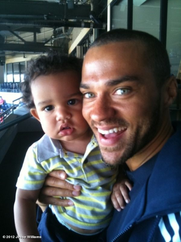 Jesse Williams holding an adorable child. Ahhhh....