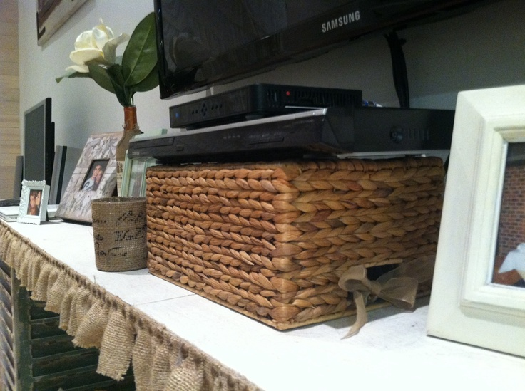 Wicker basket with the back cut out to hide wires