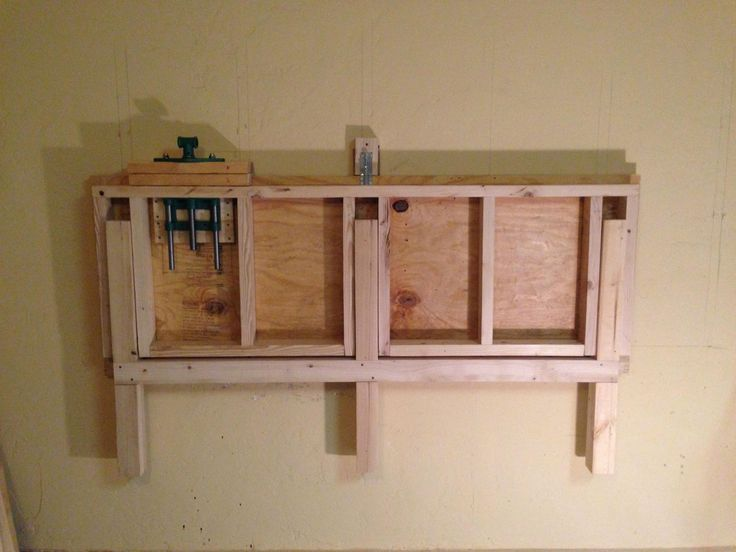 folded up on the wall fold down work bench for my garage work shop handyman tips. Black Bedroom Furniture Sets. Home Design Ideas