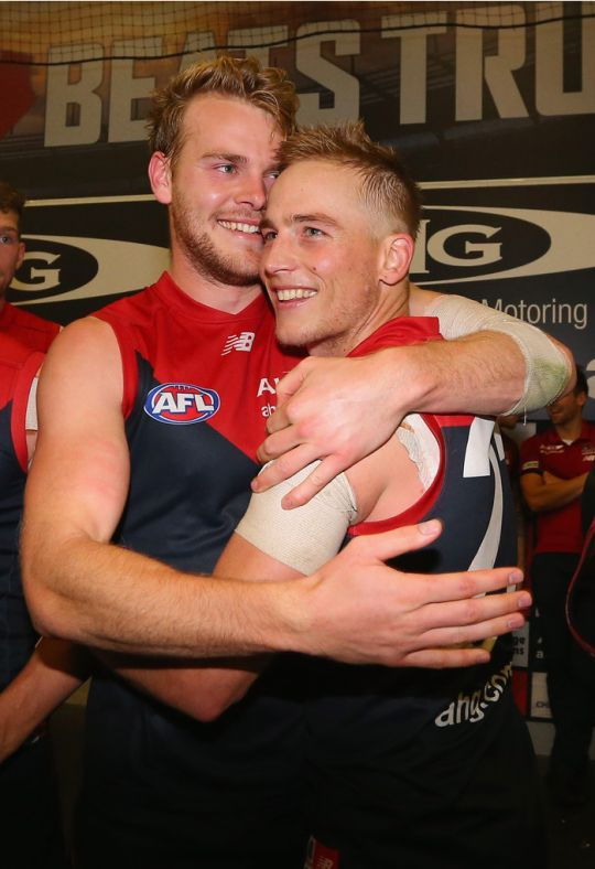 Jack Watts and Bernie Vince of the Melbourne Demons celebrate in the sheds after the match