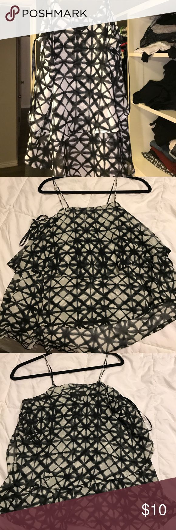 Black and white strappy top Target brand black and white strappy top. Has a top and bottom layer of fabric. Looks great with shorts or jeans. Never worn but tags have been removed! Mossimo Supply Co. Tops Tank Tops