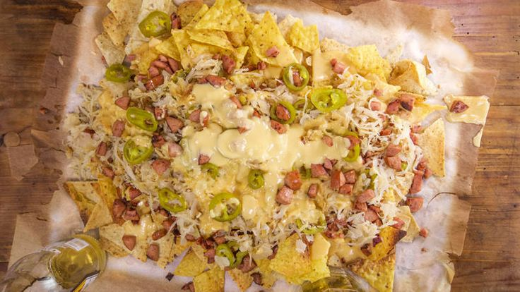 Kielbasa Nachos with Beer Cheese and 'Kraut- I'd leave off the kraut but boy does this look good!!