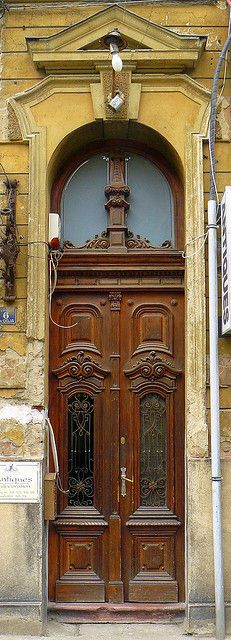 Timisoara Romania - Old Door   think they could upgrade the light over it.