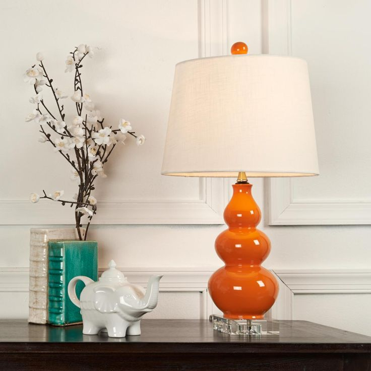 "Triple Gourd Mini Lamp on Clear Crystal Base 5 colors Triple the impact with these intense ceramic lamps on 4"" clear crystal bases. In Orange, Yellow, White, Black or Navy Blue with a hardback linen drum shade. 60 watts."