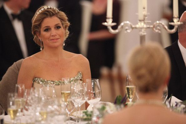 Princess Maxima Photos Photos - Princess Maxima of the Netherlands (L) looks over at German First Lady Bettina Wulff as they attend a state banquet given in honour of the visiting Dutch royals at Bellevue Presidential Palace on April 12, 2011 in Berlin, Germany. The Dutch royals, including Queen Beatrix, Prince Willem-Alexander and Princess Maxima, are on a four-day visit to Germany that includes stops in Berlin, Dresden and Duesseldorf. - HRH Queen Beatrix Of The Netherlands And Crown…