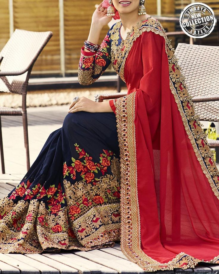 Enhance Your Glorious Glance As You Adorn This Wedding Special Saree From The Online Store Of Simaaya Fashions. Made Up Of Faux Georgette And Chiffon Fabric.  Get this outfit at - http://www.simaayafashions.com/wedding-special-faux-georgette-and-chiffon-saree-in-navy-blue-and-red-prfa7230  #redandblue #designersaree #onlineshopping #exclusive
