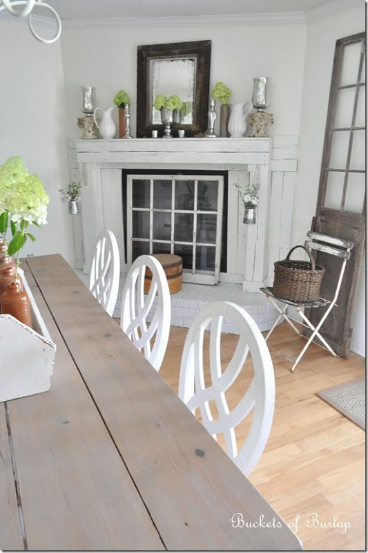 like the window in front of fireplace--The Cottage Market: Cottage of the Week: Buckets of Burlap