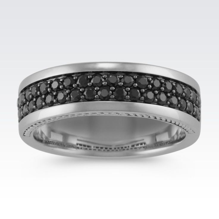 This striking 7mm men's ring boasts 35 round black sapphires, at approximately 1.11 carats total gem weight. These rich gems are pavé-set in quality 14 karat white gold with milgrain detailing on the profiles.