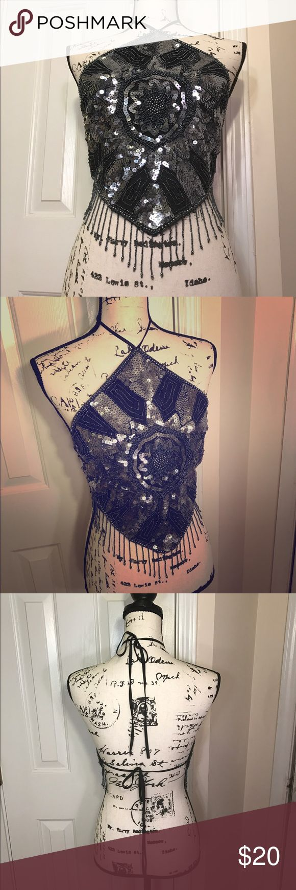 Crazy hot exposed back club/festival top This shirt (can you technically call it a shirt? ... I'm not sure 🤔) is super sexy! You're sure to catch eyes with the bling and the bare skin. Beaded and sequined front in black, grey and silver. Some light will will even bring out pinks and purples. Ties at neck and around back. Beaded tassels aligned the angular bottom hem. Black polyester lining. In PERFECT condition. Worn only one time. Size is small and true to size. This thing is HOT…