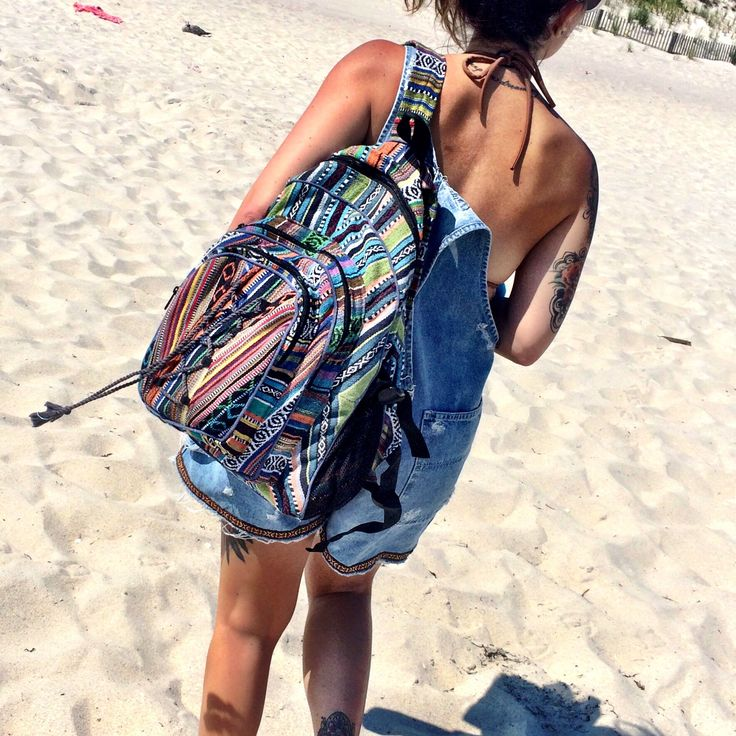 Lace Up Hippie Backpack has three zipper pouches, two mesh water bottle pockets on each side, and a top handle for easy carry. Straps are adjustable and colors may vary.