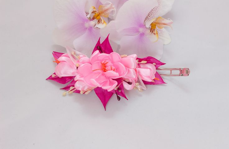 A personal favourite from my Etsy shop https://www.etsy.com/ie/listing/562466023/hair-accessory-kanzashi-flowers-pink