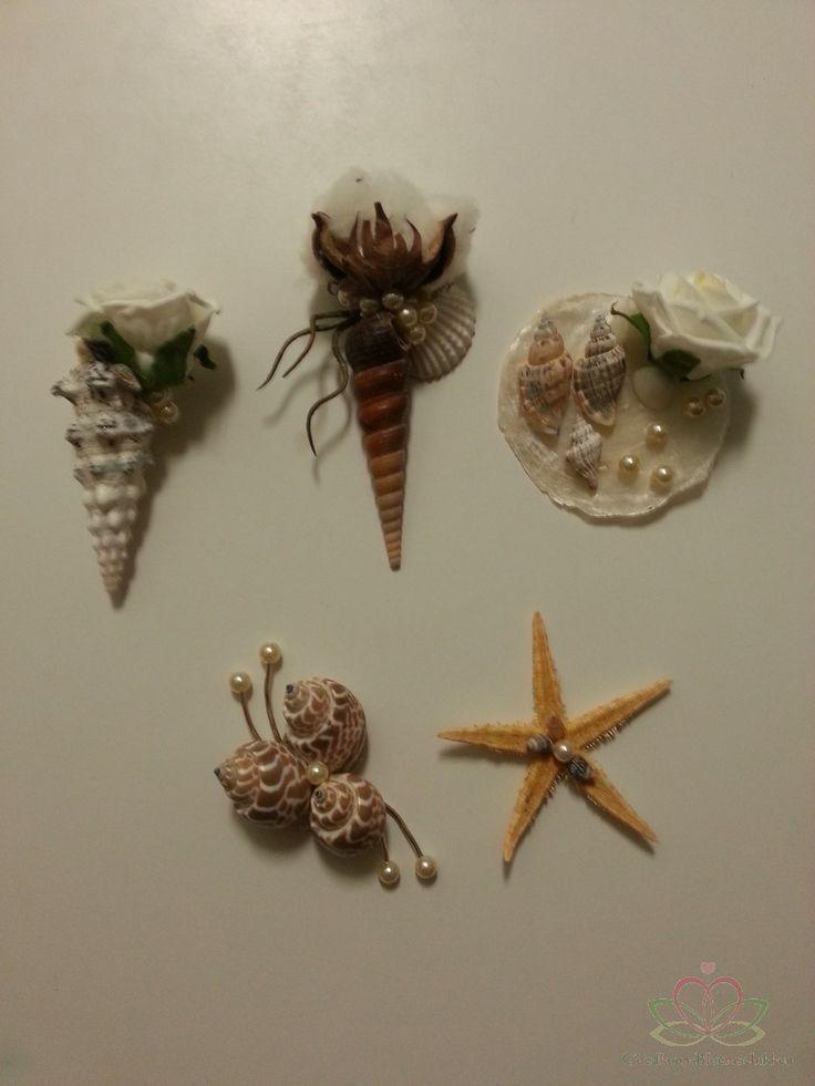 corsage van schelpen oa Capiz Terebra, White Chippi een Zeester en Katoen