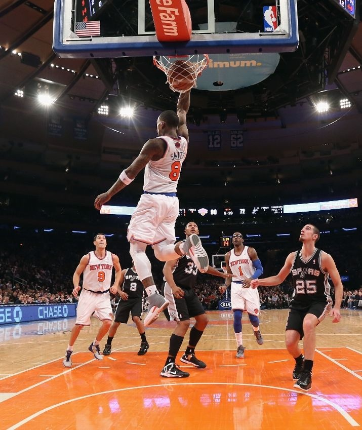 JANUARY 03: J.R. Smith #8 of the New York Knicks scores a basket behind his head late in the fourth quarter against the San Antonio Spurs