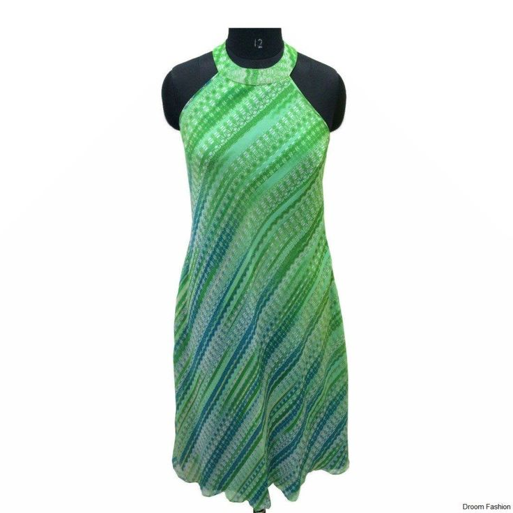 Be a breathe of fresh air in this cool green dress. The neckline makes it unique. Halter necks are totally in. #HalterNeck #Flowy #CoolGreen #DroomFashion #Gown To shop, visit us onhttp://www.droomfashion.com/product-category/women/