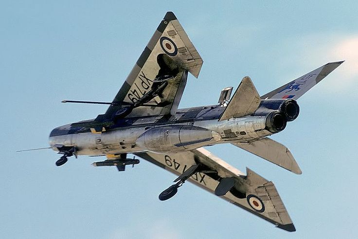 """English Electric Lightning ~~ Wikipedia ~~ on approach to landing with """"everything hanging out"""" (air brakes, landing gear, wing flaps and slats).  Bulbous fairing on fuselage underside is fuel tankage."""