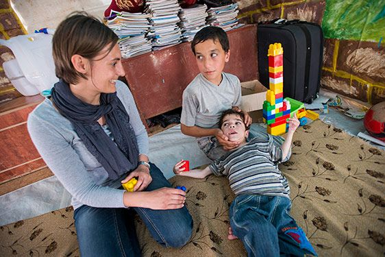Children with special needs are particularly vulnerable. At the request of concerned parents, the IRC is providing small afternoon sessions for children with special needs in three camps, encouraging them to socialize and play. (Photo: Peter Biro/IRC)
