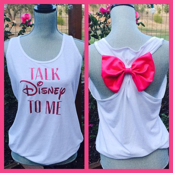 This listing is for 1, brand new, custom made Talk Disney To Me razor back T-shirt with a bow on the back.