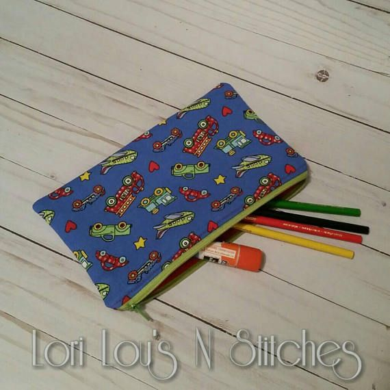 Pencil Zipper Pouch 5.5x9 Inches and great for pencils and more!  Vehicle themed fabric with solid red lining.