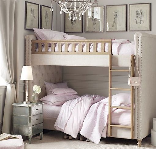 Quite amazing.  I never thought of covering bunk beds with fabric.  They are usually so ugly, but wow...with the padded headboard and footboard, the antique mirrored night stand, chandelier and the framed prints above the bed, this elevates this room by 100.