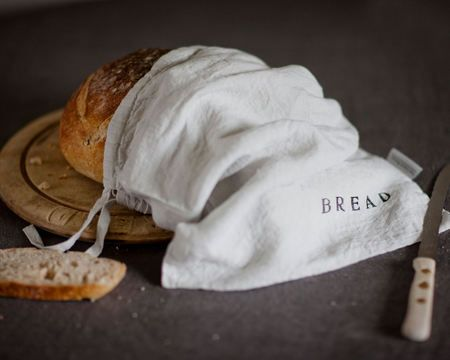 The French have always used linen bread bags for storing their bread.  madisonandmuse.com