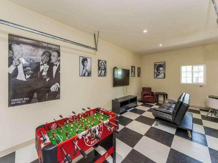 Old school Hollywood movie room in Southern California. This Anaheim home comes with a huge movie and game room to enjoy with friends and family #vacationrental #fetchmyvacay #LunamarVacationHomes