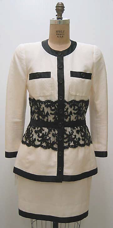 Suit  House of Chanel (French, founded 1913)  Designer: Karl Lagerfeld (French, born Germany, 1938) Date: 1991–92 Culture: French Medium: cotton, silk, plastic