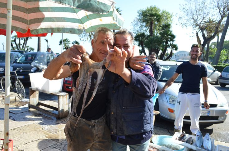 Fishermen and octopus in Bari, Italy