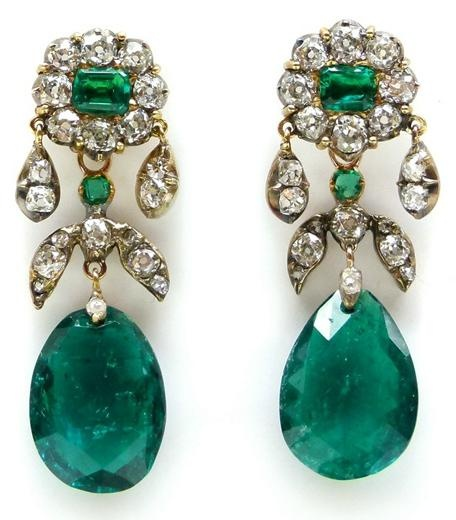 Pair of 19th century emerald drop and diamond cluster earrings, c.1880  , each hung with pear shaped emerald of double sided rose cut, from an emerald and diamond cluster top with diamond droplets, diamond foliate motif between, open set in silver and gold