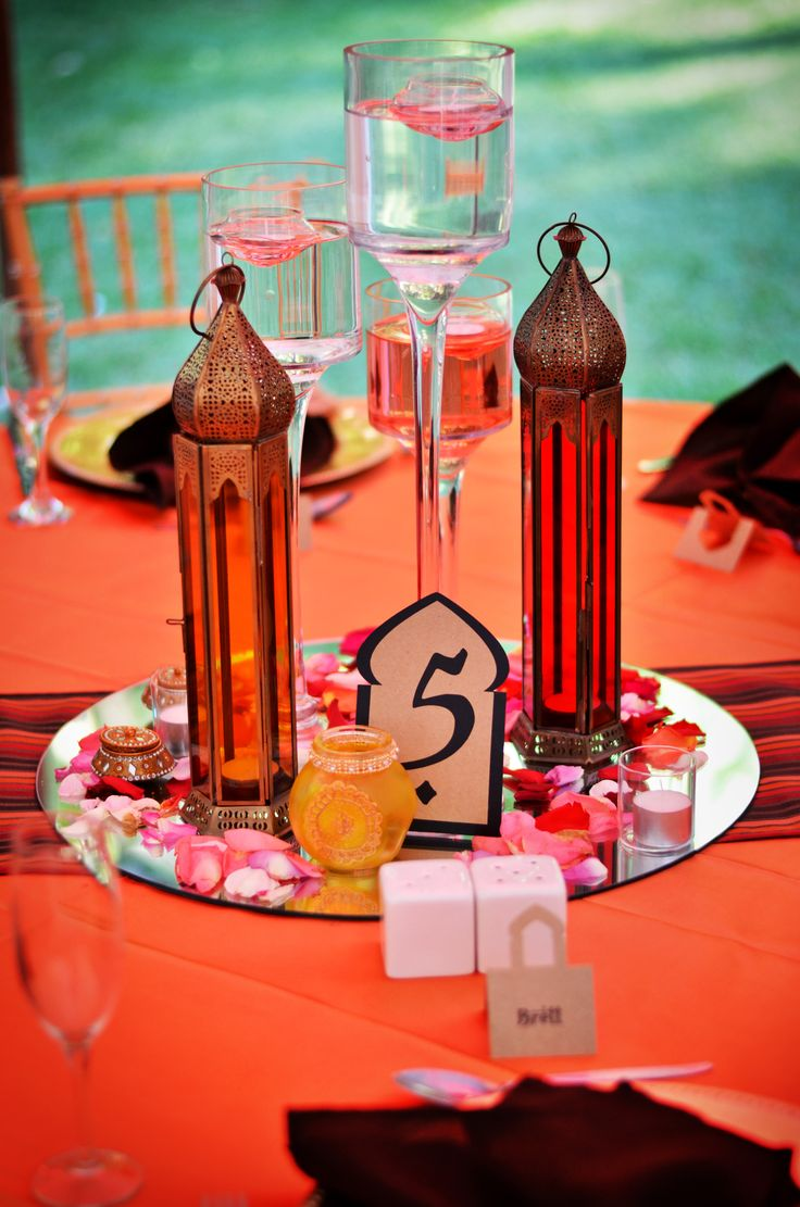 Slim, tall coloured lanterns, can place tealight candles inside. Great as centrepiece