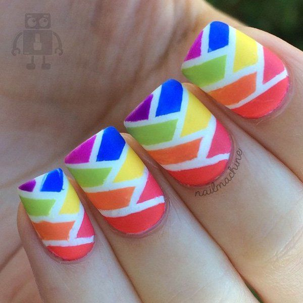 Rainbow inspired abstract nail art design. The key to making various patterns for an abstract nail art design is incorporating as much color as you can. The rainbow colors give perfect touch to the design.