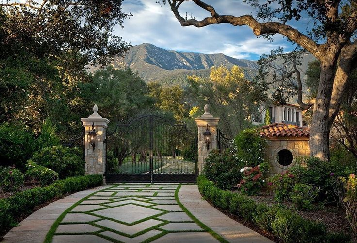 Mediterranean Landscape/Yard with Pathway, Iron entry gate, Stone and concrete pillars, Driveway, Fence, Gate