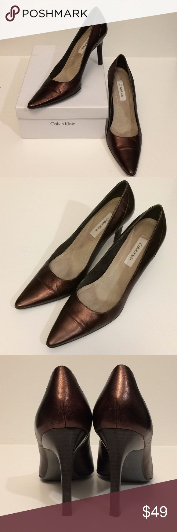 Calvin Klein Lucia Leather Pump Brown Metallic 10M Calvin Klein Lucia Leather Pump, Brown Metallic, 10M. Decadent rich bronze metallic leather, gorgeous sheen. Dark brown wood stiletto heels. EUC. Loved & gently worn, leather in very good condition, heels taps nearly new, some creasing at toes and shoes & heels have a few minor scuffs (see pics). Comfortable yet sexy. Elegant pumps for desk to dinner, beautiful w/ a silk blouse & wide leg trousers or culottes, a pencil skirt, silky cami…