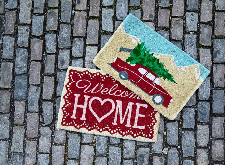 Holiday-themed doormats by Carolyn Donnelly Eclectic