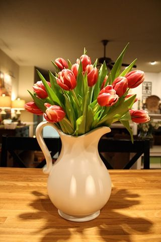 Centerpiece for kitchen counter. Buy fake flowers for each season