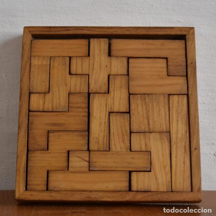 Rompecabezas con piezas de madera * juego de inteligencia * ingenio