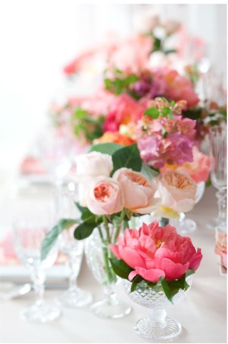 Use pretty vintage and antique crystal stems or bowls to make a lovely low centerpiece on tables. This is simple yet elegant at the same time.