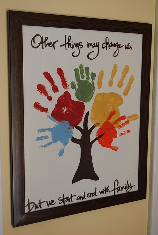 """Family hand prints on tree: """"Other things may change, but we start and end with family"""""""