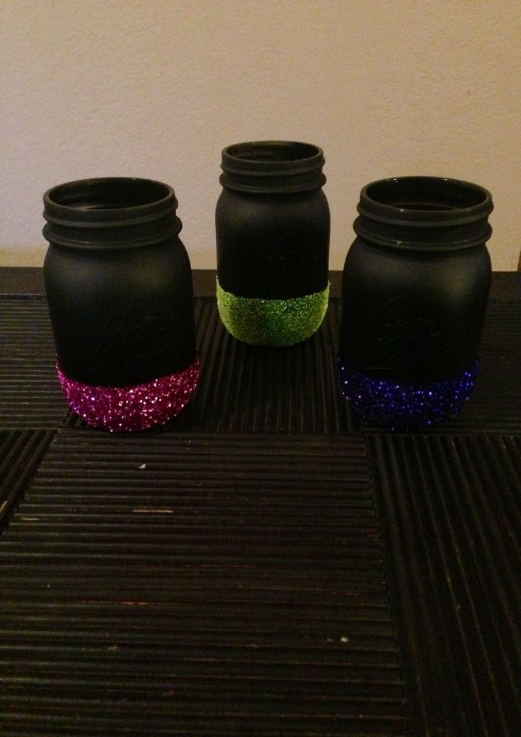 Spray paint mason jars. Paint with modge podge. Add glitter. Spray with clear sealer.