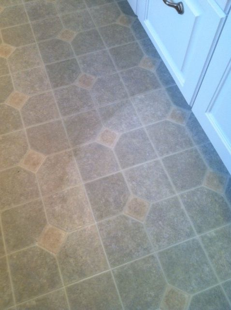 Scrubbing bubbles did this it really gets the dirt up for Hard vinyl floor tiles