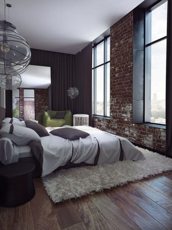 Industrial chic with exposed brick and wide floor boards. Shag rugs and contemporary lighting add eclectic character.