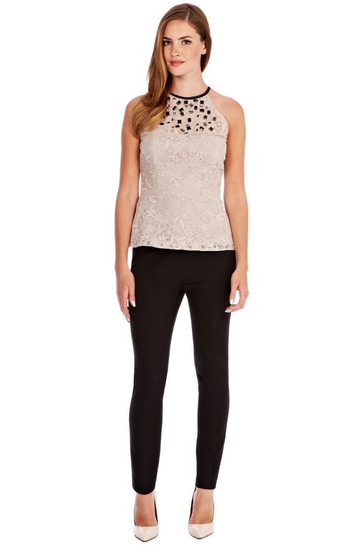 This delicate lace top features a sheer lace neck adorned in sparkling beads and crystal embellishment. The Valence Top has a flatteringly elegant halter neck that is finished with a contrasting trim at the neck.  The sheer back panelling and back keyhole detail make for an alluring look. Layer over slim leg trousers for a chic look.