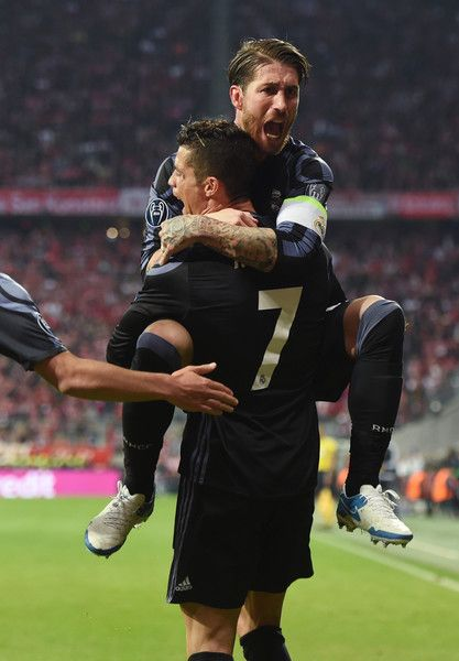 Real Madrids Portuguese striker Cristiano Ronaldo (L) and Real Madrids defender Sergio Ramos (R)celebrate after the second goal during the UEFA Champions League 1st leg quarter-final football match FC Bayern Munich v Real Madrid in Munich, southen Germany on April 12, 2017..Security was ratcheted up in Munich, one day after three explosions rocked the team bus of German football club Borussia Dortmund minutes after the bus set off to a planned Champions League game against Monaco on Tuesday…